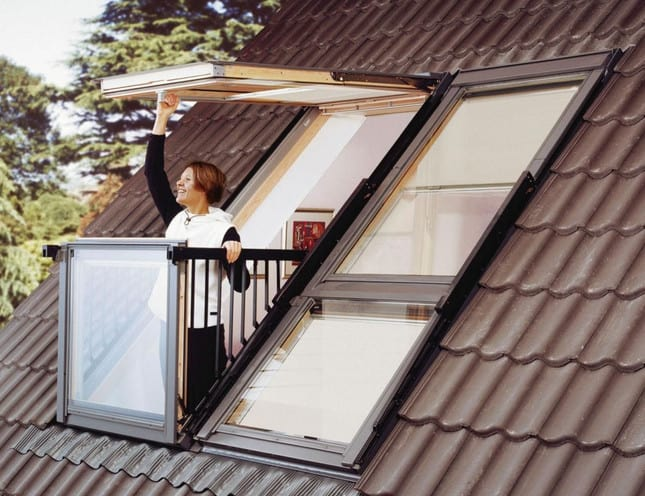 woman opening a rooftop glass window in her Sydney house